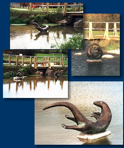 Otter family sculpture